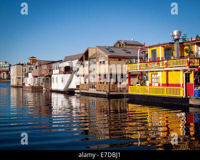 A view of colourful houseboats and businesses at quaint Fisherman's Wharf in Victoria, British Columbia, Canada. - Stock Photo