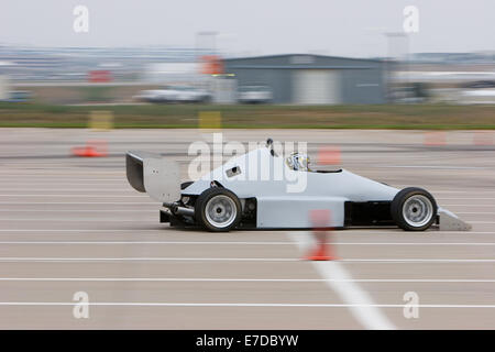 A B-Modified autocross race car in a regional Sports Car Club of America (SCCA) event crossing a finish line - Stock Photo