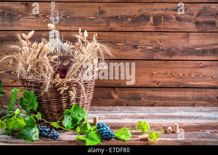 Demijohn of red wine in the cellar - Stock Photo
