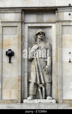 Poland. Warsaw. Socialist relief. Constitution Square. - Stock Photo