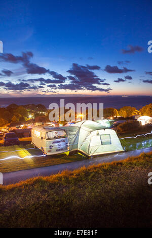 VW camper van with awning on a campsite in Devon UK - Stock Photo