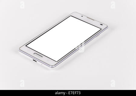 White modern smartphone with blank screen lies on the surface, isolated on white background. Selective focus - Stock Photo