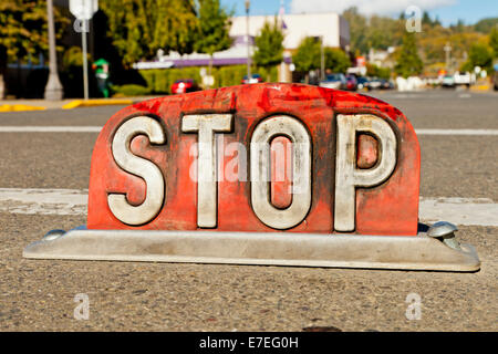 A stop sign set into the road on 3rd Street, Raymond just off Highway 101 - Stock Photo