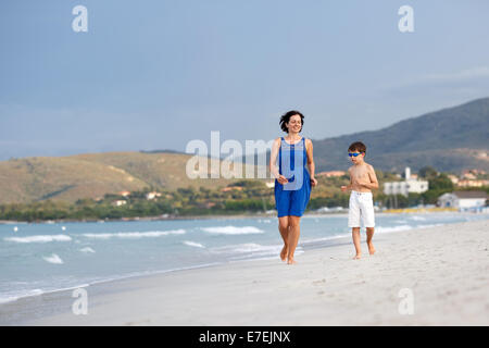 Mother and son on tropical beach - Stock Photo