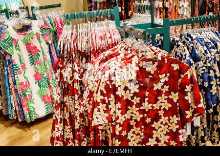 Hawaii Oahu Hawaiian Honolulu Ala Moana Center centre mall shopping sale display retail aloha shirts floral pattern - Stock Photo