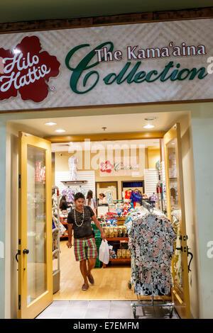 Hawaii Oahu Hawaiian Honolulu Ala Moana Center centre mall shopping sale display retail shirts floral pattern Hilo - Stock Photo
