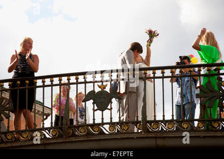 Celebrating a Wedding on one of St. Petersburg's Bridges - Stock Photo