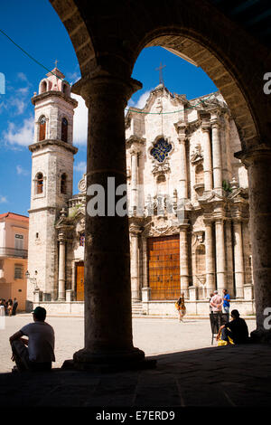 Catedral de la Habana is visible through arches across the cathedral plaza in Havana, Cuba. - Stock Photo