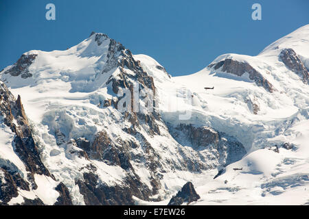Mont Blanc and the Bossons glacier from the Aiguille Rouge, France, with two pleasure flight planes. - Stock Photo