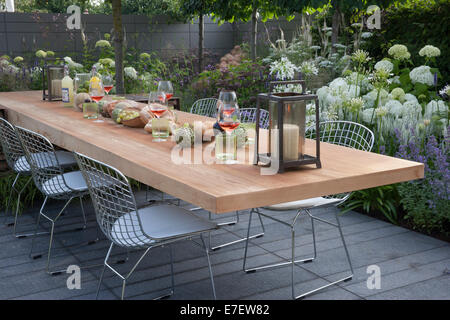 Garden - Vestra Wealth's Vista - view of patio with floating table and chairs outdoor living and planting of Ag - Stock Photo