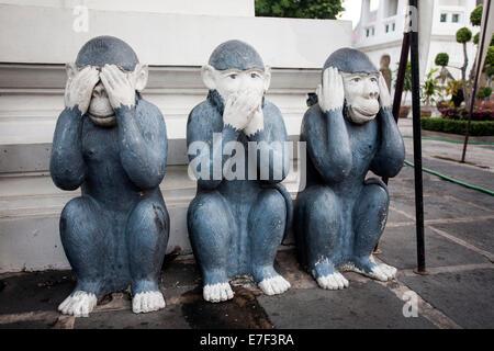 Three monkeys, see nothing, say nothing, hear nothing, Wat Arun, Bangkok, Thailand - Stock Photo