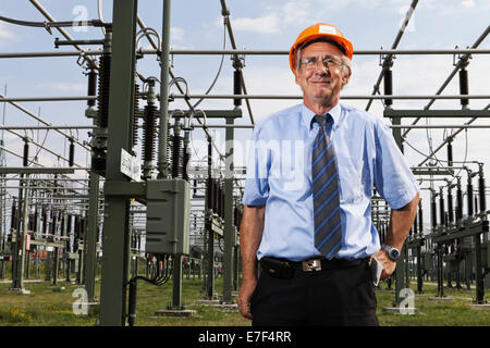 Engineer at the substation of the Transmission Control Center, TCC, of transmission network operator 50Hertz, Neuenhagen - Stock Photo
