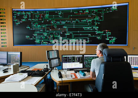 Engineer sitting at his work station in the Transmission Control Center, TCC, of transmission network operator 50Hertz - Stock Photo
