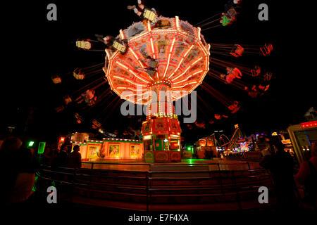 Chairoplane at night, Oktoberfest, Munich, Bavaria, Germany - Stock Photo