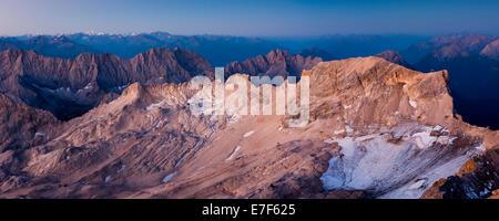 Sunrise, view from Mt Zugspitze of Mt Schneefernerkopf towards Tyrol, Zugspitzplatt, high karst plateau, Wetterstein - Stock Photo