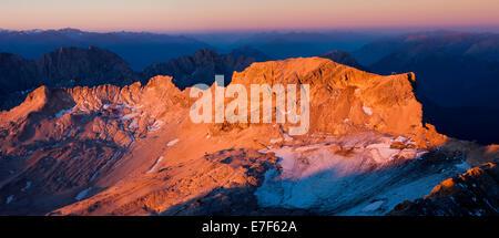 Sunrise view from Mt Zugspitze to Mt Schneefernerkopf, towards Tyrol, Zugspitzplatt, high karst plateau, Wetterstein - Stock Photo