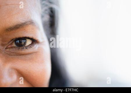Close up of mixed race woman's eye - Stock Photo