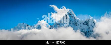 Clouds surrounding snowy mountaintops, Tengboche, Khumbu, Nepal - Stock Photo