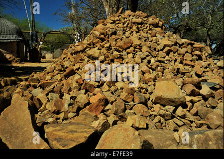 KwaZulu-Natal, South Africa, Isivivane, traditional pile of stones marking Zulu warriors grave, Shakaland cultural - Stock Photo