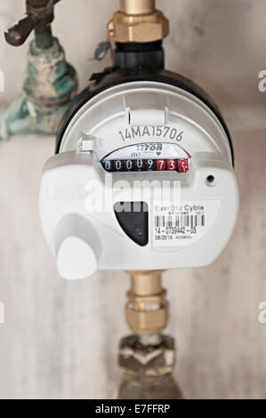 a water meter under a domestic sink with moldy walls the uk these meters have radio signals for collecting readings - Stock Photo