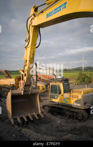 digger diggers bucket scoop hydraulic arm hydraulics arms earth mover movers earthmovers earthmover yellow dig digging - Stock Photo