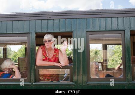 Woman waving from train window, Chemin de Fer de la Baie de Somme, Picardy, France, Europe - Stock Photo