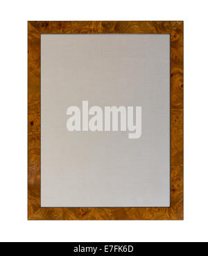 Cloth based pinboard or notice board inside a shiny attractive wood grain picture  frame isolated against white - Stock Photo