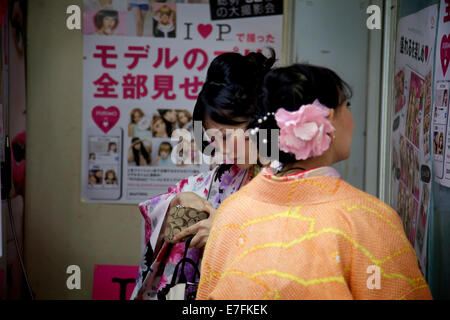 Japanese women dressed with yukata, traditional garment. Kyoto, Japan, Asia - Stock Photo