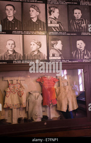 Photos and clothes of child victims on display at the Auschwitz concentration camp, Auschwitz, Poland - Stock Photo