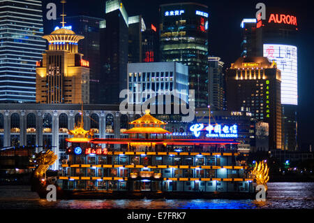Pudong Skyline, by night, Shanghai, China. Skyline of Pudong as seen from the Bund, with landmark Oriental Pearl - Stock Photo