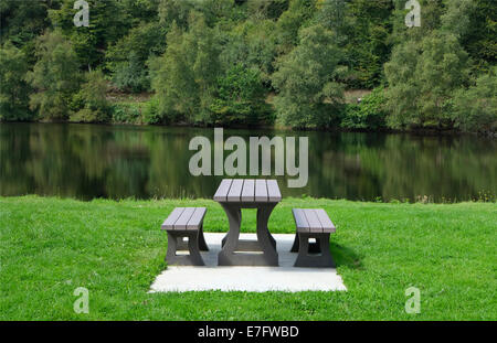 picnic table in countryside setting - Stock Photo