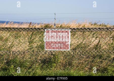 Keep Out Dangerous Cliffs sign. - Stock Photo