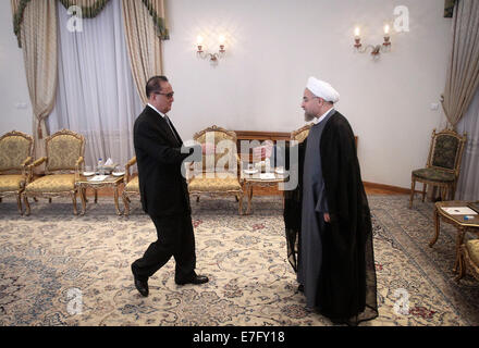 Tehran, Iran. 16th Sep, 2014. Iranian President Hassan Rouhani (R) meets with Ri Su Yong, Foreign Minister of the - Stock Photo