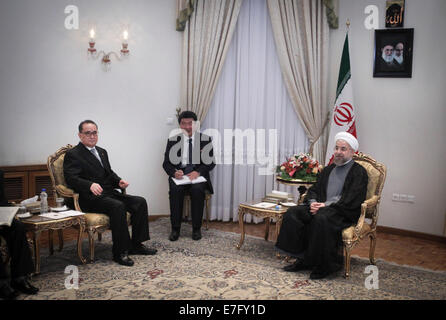 Tehran, Iran. 16th Sep, 2014. Iranian President Hassan Rouhani (R) meets with Ri Su Yong (L), Foreign Minister of - Stock Photo