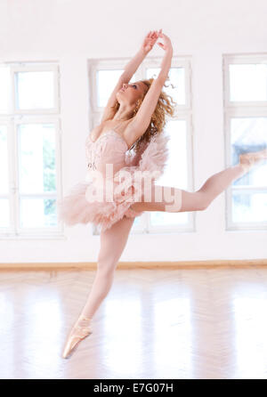 Careless and beautiful ballerina jumping in the air. - Stock Photo