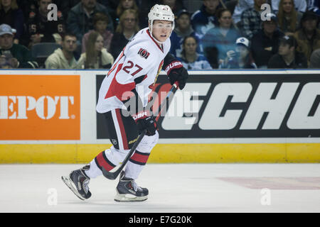 September 14, 2014. Curtis Lazar (27) follows the play during a game between the Toronto Maple Leafs and the Ottawa Senators at the 2014 NHL Rookie Tournament being played at Budweiser Gardens.