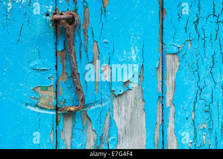 Paint flaking off old wooden door - Stock Photo
