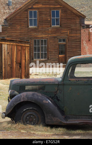 Derelict vintage truck and old buildings, Bodie Ghost Town, Bodie Hills, Mono County, Eastern Sierra, California, - Stock Photo