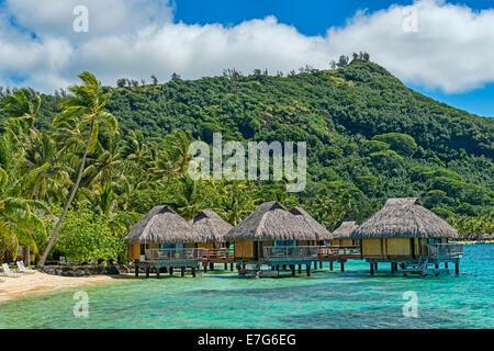 Overwater bungalows in the lagoon, Bora Bora, French Polynesia - Stock Photo