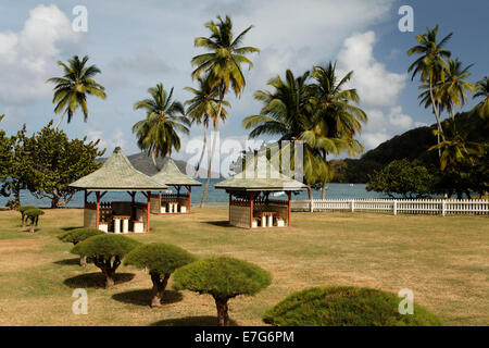 Barbecue huts on the beach, coconut trees, Speyside, Tobago, Trinidad and Tobago - Stock Photo