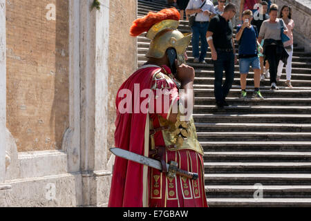 Italy: Roman legionary with smartphone at Spanish Steps in Rome . Photo from 5th September 2014. - Stock Photo