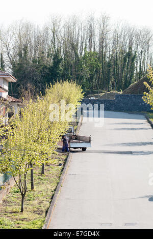 small street with a man and truck - Stock Photo