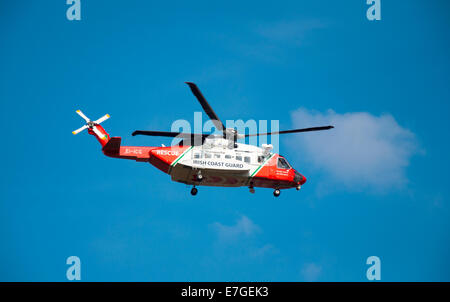 Irish Coast Guard IRCG  Garda Cósta na hÉireann Sikorsky helicopter flies above during a medical rescue in rural - Stock Photo