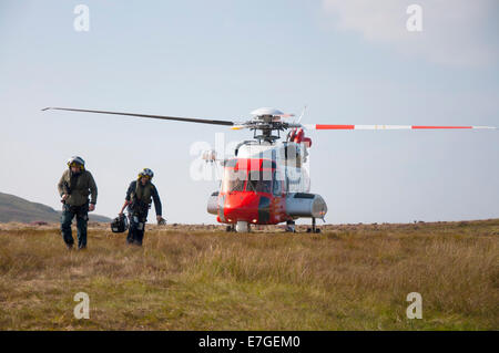 Irish Coast Guard IRCG  Garda Cósta na hÉireann Sikorsky helicopter lands on the bog during a medical rescue in - Stock Photo