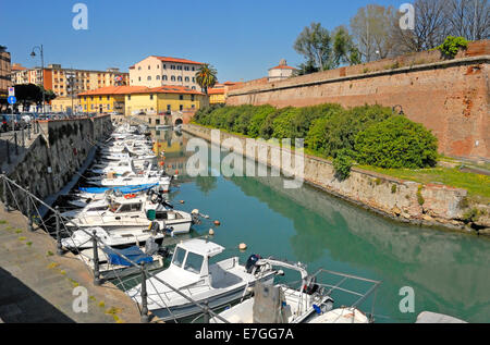 Livorno, Tuscany, Italy. Boats moored in the moat of the Fortezza Nuova - Stock Photo