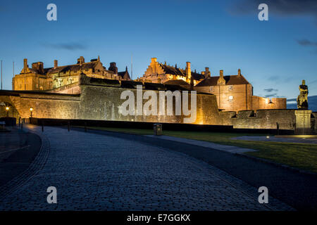 Twilight below Robert the Bruce statue and the entry to Stirling Castle, Stirling, Scotland - Stock Photo