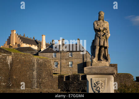 Robert the Bruce statue and Stirling Castle - birthplace of Mary Queen of Scots, Stirling, Scotland, UK - Stock Photo