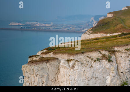 Misty morning over the White Cliffs of Dover and Dover Harbor, Kent, England - Stock Photo