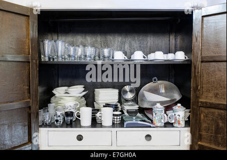 kitchen cabinet with traditional utensils and tools - Stock Photo