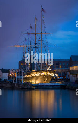 Twilight over Brunel's SS Great Britain - worlds first steam-powered passenger liner, now a museum in dry dock, - Stock Photo